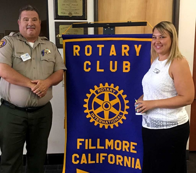Rotary President Dave Wareham presented a Rotary mug to speaker, Caitlin Barringer, from the American Cancer Society. She spoke about the upcoming Relay for Life which will be held September 23rd and 24th. Photo courtesy Martha Richardson.