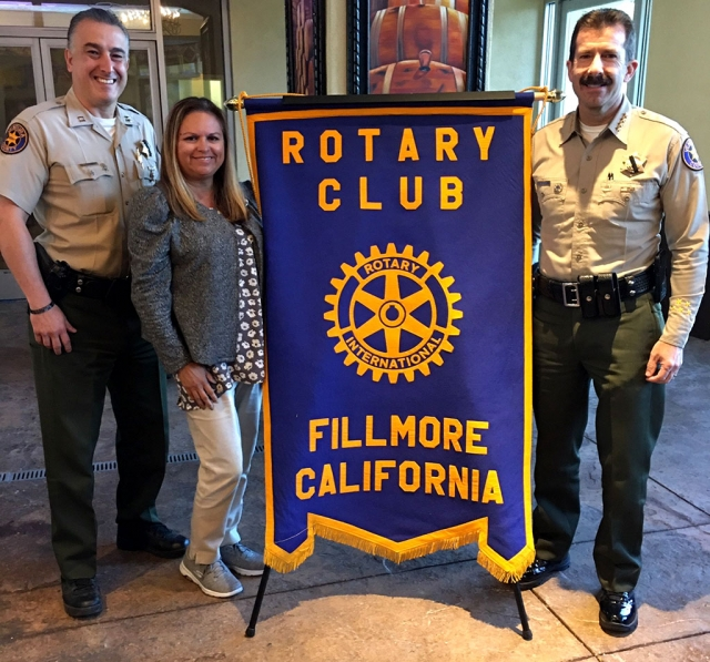 Last week Rotary Club of Fillmore President Ari Larson inducted Fillmore Police Chief Garo Kuredjian (far left) into Rotary. Also pictured far right is Ventura County Sheriff Bill Ayub who presented the program to the club last week. Photo Courtesy Martha Richardson.