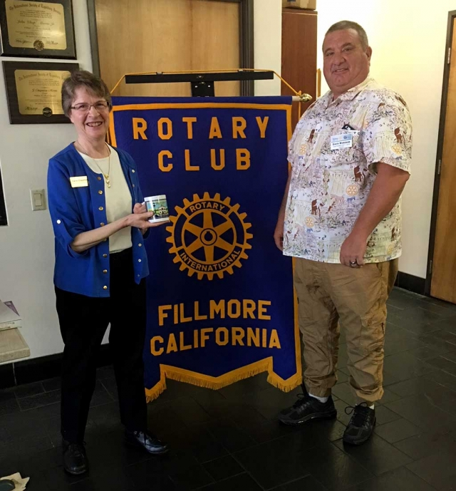 Fillmore Rotary Club hosted Carol Chapman, Ventura County Library Adult Literacy Program Manager, who spoke on the different styles of teaching adults to read and how this free program has changed people's lives. Information on this free service can be obtained at any VC library. Pictured is Rotary member Dave Wareham presenting Carol with a Rotary mug as a thank you. Photo courtesy Martha Richardson.