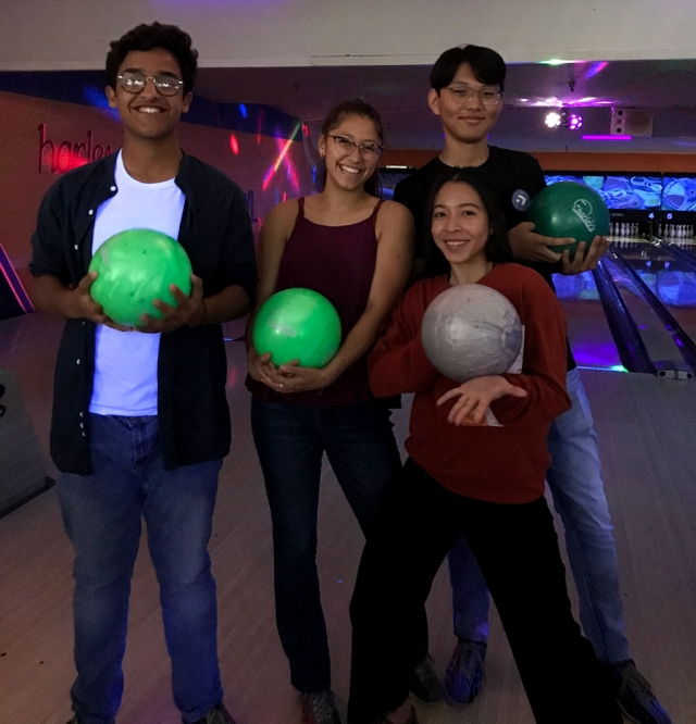"This year's foreign exchange students are (l-r) Mujtaba ""Tabs"", Tori Gonzales (host sister), Napason ""Benz"", and Munkh, having some fun at a bowling alley together."