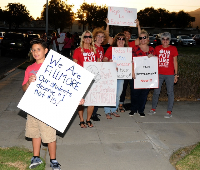 Members of the Fillmore Unified Teachers Association, along with parents and community members, picketed the FUSD building, with cars driving by honking in support.
