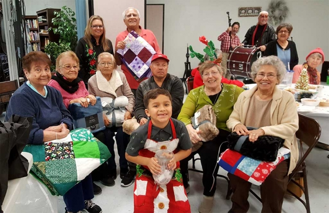 Thanks to the mini grant we received from the 100 Women who care about Ventura County, the Santa Clara Valley was able to donate 8 blankets and handmade quilts to seniors attending the event! Attendees had a lot of fun listening to the music of the