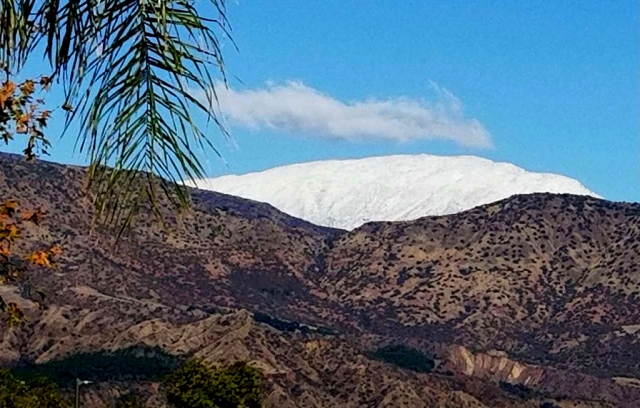 Beginning early Monday morning into the evening a rainstorm blew through Ventura County bringing heavy rains and winds, but it left behind Christmas week snow on the Sespe Mountain Range.
