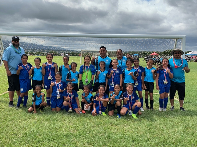"Pictured above and below is the Fillmore ASYO Warrior's 10U Girls Team traveled to Hawaii to compete in the AYSO National Games. Pictured is the team holding up the ""Hang Loose"" sign while they were on the island. Photo Credits Arnold Munoz."