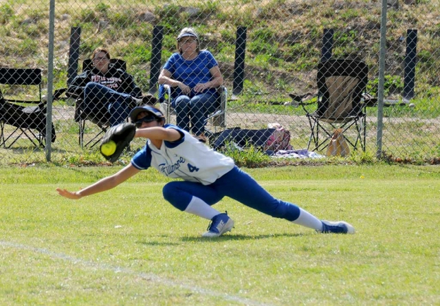 Varsity Outfielder Ebony Venegas makes a diving catch in left field during the St. Bonnaventure game this past Thursday.