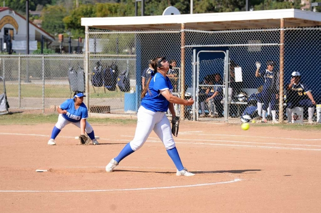 Flashes JV player Zoie Isom pitching to the Santa Clara batters while the Flashes defense sits ready to make a play against Santa Clara. Fillmore beat Santa Clara 12-5.