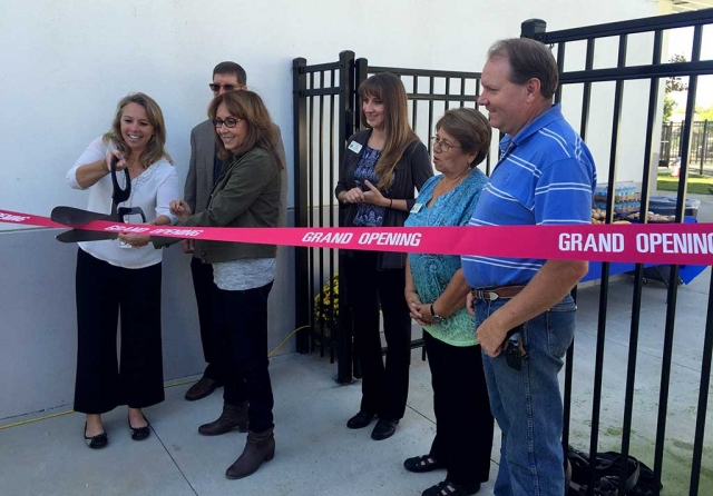 Cutting the Grand Opening ribbon with Ms. De La Piedra is the new Preschool Director Holly Harvan.