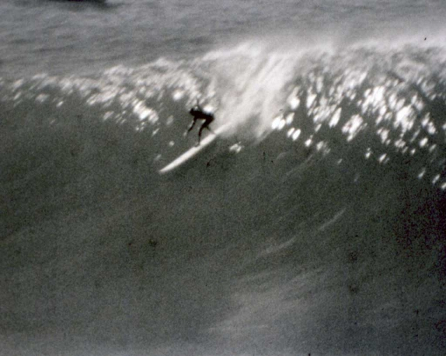 Sarah Gerhardt flies down the face of a wave at Maverick's. (photo: One Winter Story Archive)