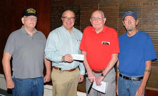 On Friday morning, October 11th, at the Fillmore Veterans Memorial Building, John Pressley of Fillmore donated a check for $1,000 to the Veterans Memorial building fund towards the roof repairs needed for the building.