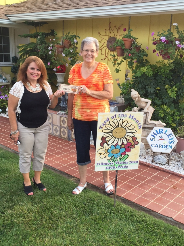 Theresa Robledo with Civic Pride Vision 2020 presents Yard of the Month to Shirley Spitler! Congratulations!  Please drive by 850 Oliver Street to view her gorgeous yard!  You will find at Shirley's home, roses, Christmas cactus, a lot of geraniums, succulents, and many beautiful garden statues. When I asked Shirley what inspires her to garden, she said, about 10 years ago her late husband, Bud Spitler, said do you want to trade grocery shopping for gardening?  Obviously, Shirley accepted and has been gardening ever since! Thank you to Otto & Sons Nursery for their generous gift certificate, where she will enjoy finding more items for her yard!