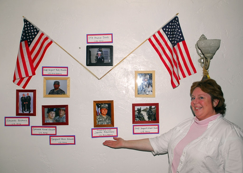 Mama Sue shows her display of the men and women of Fillmore and Piru who are serving in the United States Military.