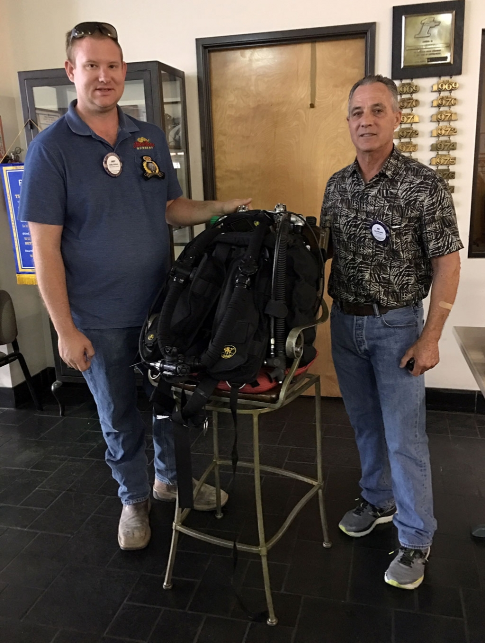 Pictured is Rotary President Andy Klittich with Rotary Member Joe Ricards who presented to the club about being a certified scuba instructor in several specific areas. He brought along his most recent equipment, a rebreather which allows him to stay underwater for up to three hours at 130 feet. He described his dives and places he has gone, and his passion for the sport. Photo courtesy Martha Richardson.