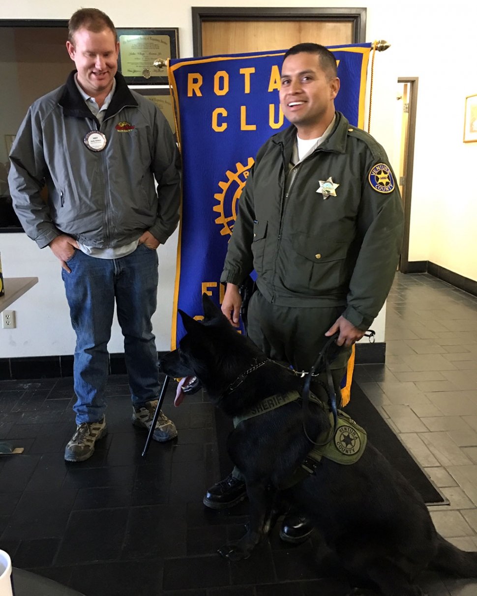 Pictured is Fillmore Rotary President Andy Klittich with Deputy Javier Rodriguez and his K-9 Jago. Deputy Rodriguez shared with the group that he has been with the Department for 13 years and has been a handler for six months. The group learned there are only six K-9's in the county and all have been hand-picked in Germany. Specific dogs are chosen for the area they will be working in. Each handler must train their dog and pay for all the dogs expenses, but do receive some help from the K-9 nonprofit Foundation. Jago is 19 months old and a German shepherd. He will be a working dog for 6-7 years before he is retired. Photo courtesy Martha Richardson.