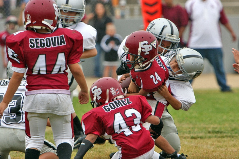 An Unknown Mighty Mite Silver Player takes down a Cardinal Runner.