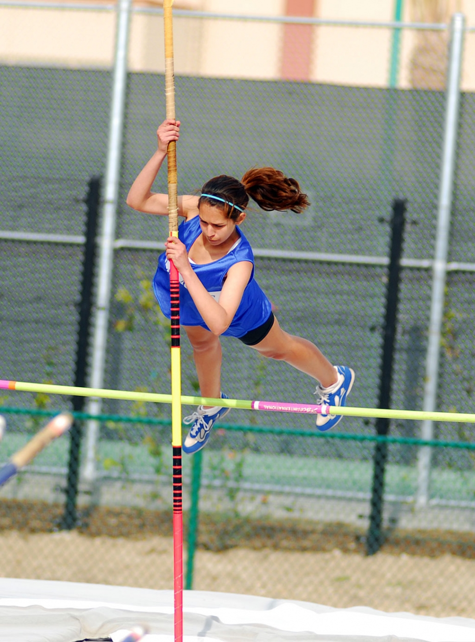 Kayla Brunett does a fantastic job on the Pole Vault.
