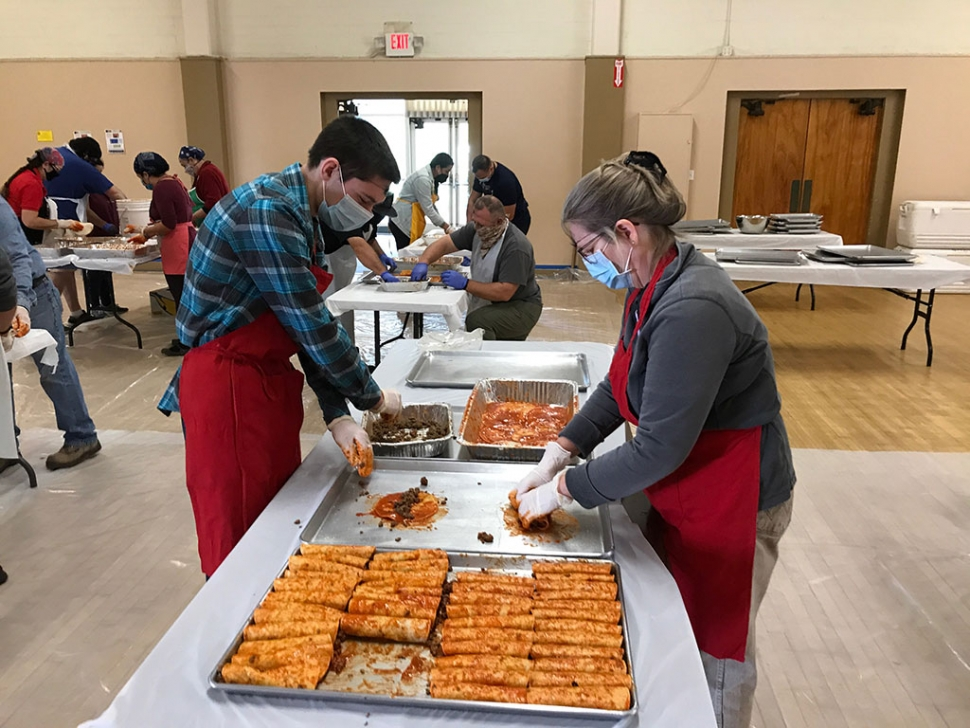Fillmore Lions Club held their Annual Enchilada Dinner at the Veterans Memorial Building on Saturday, November 7th. Due to the COVID-19 pandemic, this year's dinner was slightly different—no sitting and eating together as they had in past years. Volunteers James and Colleen Chandler are shown assembling enchiladas.