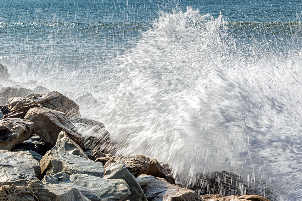 "Photo of the Week ""King Tide wave crashing on boulders at Faria County Park"" By Bob Crum. Photo data: Canon 7DMKII camera, Tamron 16-300mm lens @57mm. Exposure; ISO 200, aperture f/32, 1/40th second shutter speed."