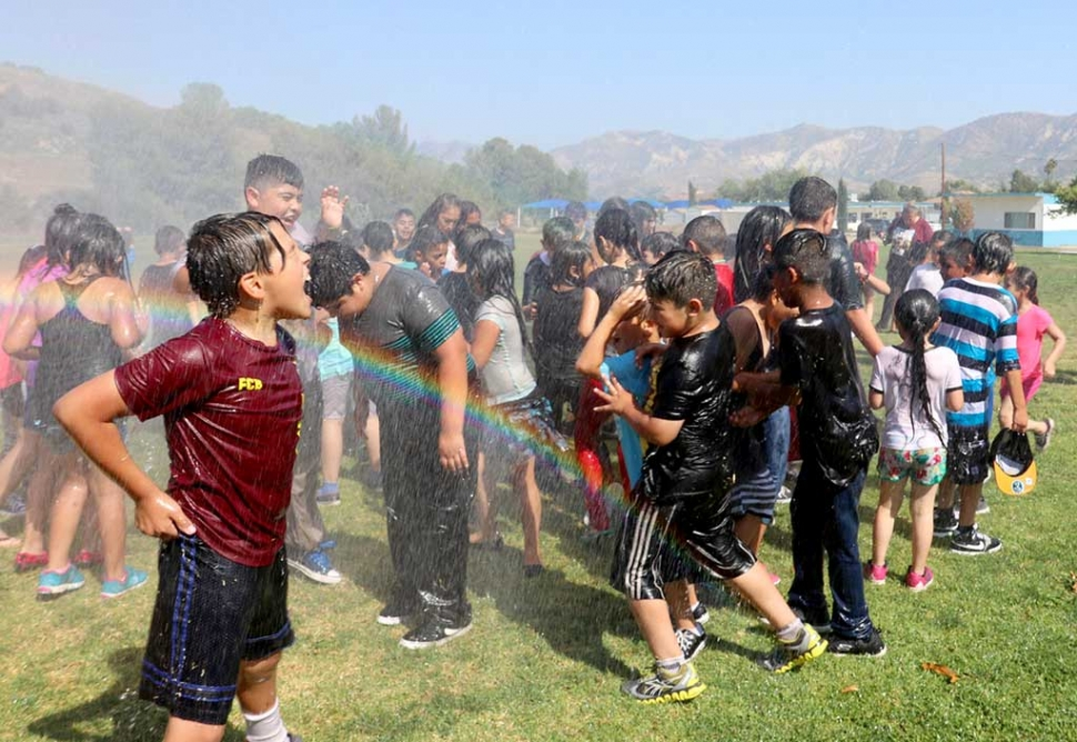 On Friday, June 2nd Fillmore Fire Crews hosted their Annual Wet Down with the kids at San Cayetano Elementary School. With perfect weather the kids were able to enjoy playing in the cool water from Fillmore Fire Stations Unit 91. Photos Courtesy Sebastian Ramirez.